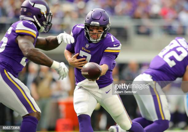 Case Keenum of the Minnesota Vikings hands the ball off to Latavius Murray in the second half of the game against the Detroit Lions on October 1 2017...