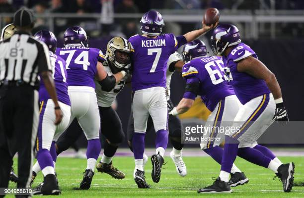 Case Keenum of the Minnesota Vikings is hit while passing in the second quarter of the NFC Divisional Playoff game against the New Orleans Saints on...