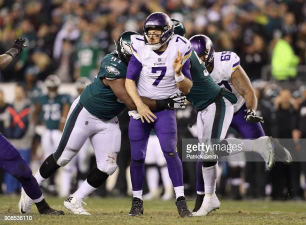 Case Keenum of the Minnesota Vikings is tackled by Fletcher Cox of the Philadelphia Eagles during the fourth quarter in the NFC Championship game at...