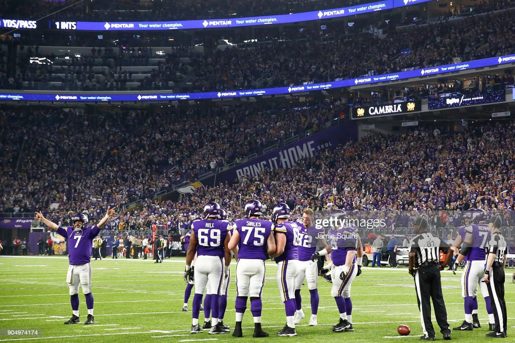 Case Keenum #7 of the Minnesota Vikings leads a cheer after a touchdown against the New Orleans Saints in the NFC Divisional Playoff game at U.S. Bank Stadium on January 14, 2018 in Minneapolis, Minnesota.