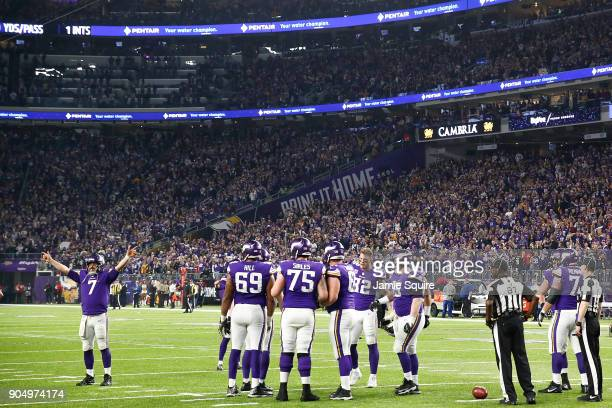 Case Keenum of the Minnesota Vikings leads a cheer after a touchdown against the New Orleans Saints in the NFC Divisional Playoff game at US Bank...