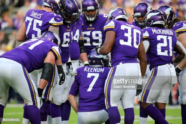 Case Keenum of the Minnesota Vikings leads a huddle in the first half of the game against the Chicago Bears on December 31 2017 at US Bank Stadium in...
