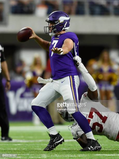 Case Keenum of the Minnesota Vikings looks to pass the ball under pressure from Eli Harold of the San Francisco 49ers during the third quarter in the...