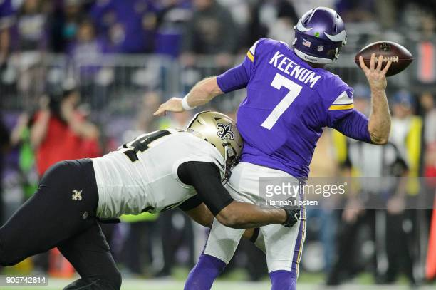 Case Keenum of the Minnesota Vikings passes the ball under pressure from Cameron Jordan of the New Orleans Saints of the NFC Divisional Playoff game...