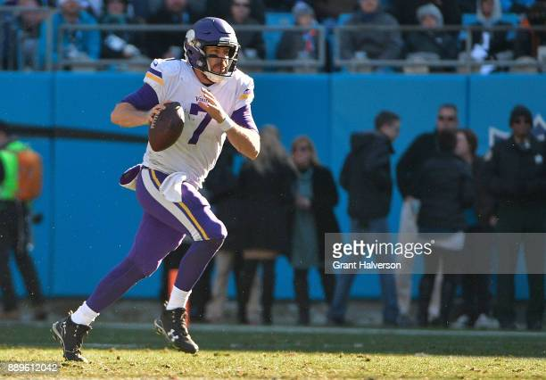 Case Keenum of the Minnesota Vikings rolls out against the Carolina Panthers during their game at Bank of America Stadium on December 10 2017 in...