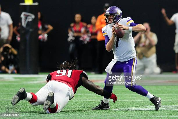 Case Keenum of the Minnesota Vikings scrambles away from Courtney Upshaw of the Atlanta Falcons during the second half at MercedesBenz Stadium on...