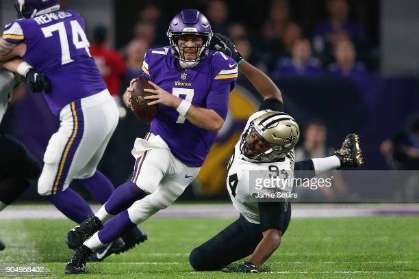 Case Keenum of the Minnesota Vikings scrambles with the ball chased by Cameron Jordan of the New Orleans Saints during the first half of the NFC...