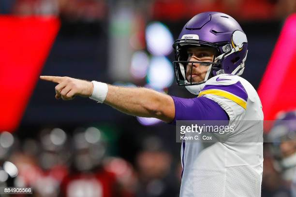 Case Keenum of the Minnesota Vikings signals for a first down during the first half against the Atlanta Falcons at MercedesBenz Stadium on December 3...