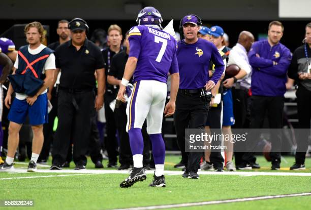 Case Keenum of the Minnesota Vikings speaks with offensive coordinator Pat Shurmur in the second quarter of the game against the Detroit Lions on...