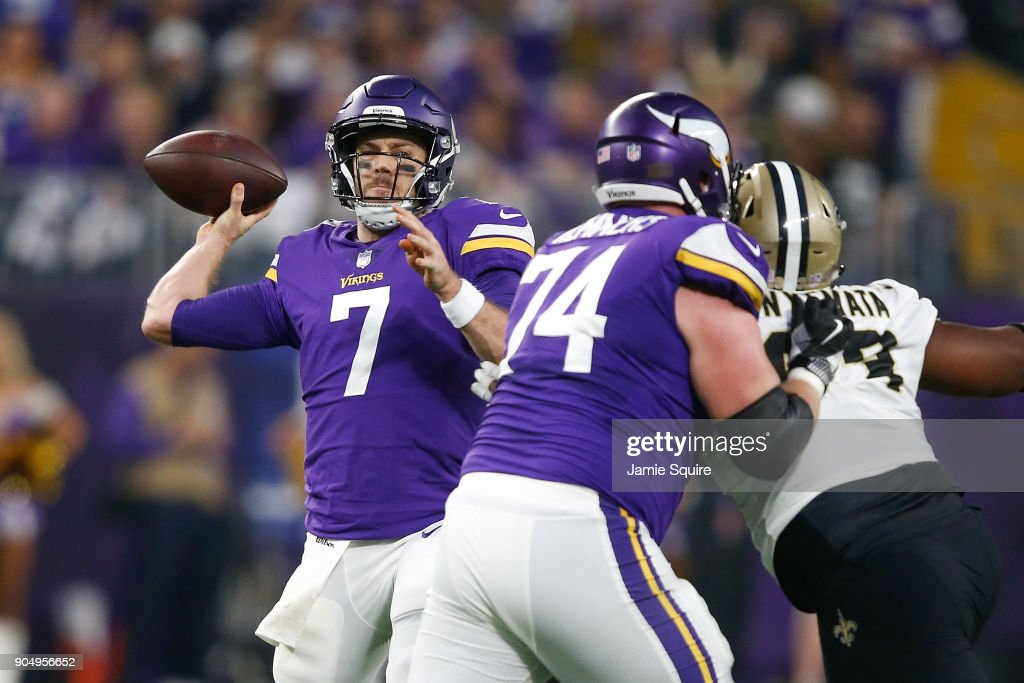 Case Keenum #7 of the Minnesota Vikings throws a pass against the New Orleans Saints during the first half of the NFC Divisional Playoff game at U.S. Bank Stadium on January 14, 2018 in Minneapolis, Minnesota.