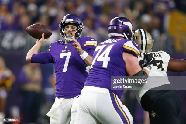 Case Keenum of the Minnesota Vikings throws a pass against the New Orleans Saints during the first half of the NFC Divisional Playoff game at US Bank...
