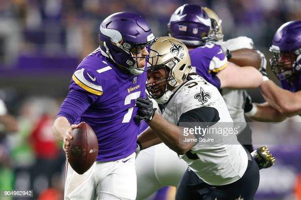 Case Keenum of the Minnesota Vikings tries to escape pressure from Cameron Jordan of the New Orleans Saints during the second half of the NFC...