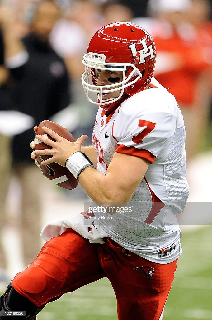 Case Keenum #7 of the University of Houston Cougars scrambles with the ball during a game against the Tulane Green Wave being held at the Mercedes-Benz Superdome on November 10, 2011 in New Orleans, Louisiana.