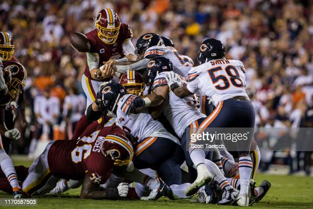 Case Keenum of the Washington Redskins gets the ball punched out of his hands against the Chicago Bears during the second half at FedExField on...