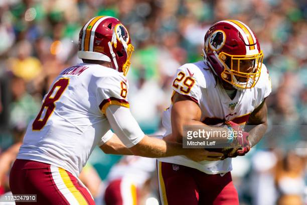 Case Keenum of the Washington Redskins hands the ball off to Derrius Guice against the Philadelphia Eagles at Lincoln Financial Field on September 8,...
