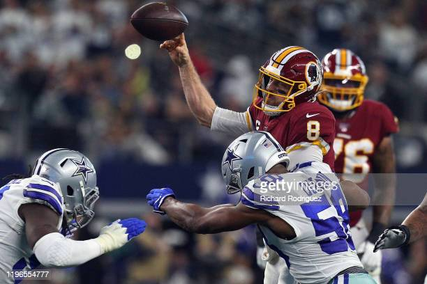 Case Keenum of the Washington Redskins passes under pressure from Robert Quinn of the Dallas Cowboys at ATT Stadium on December 29 2019 in Arlington...