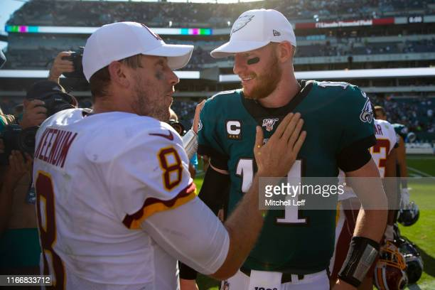 Case Keenum of the Washington Redskins talks to Carson Wentz of the Philadelphia Eagles after the game at Lincoln Financial Field on September 8 2019...