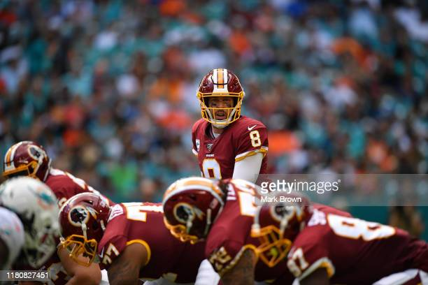 Case Keenum of the Washington Redskins under center against the Miami Dolphins in the first quarter at Hard Rock Stadium on October 13 2019 in Miami...