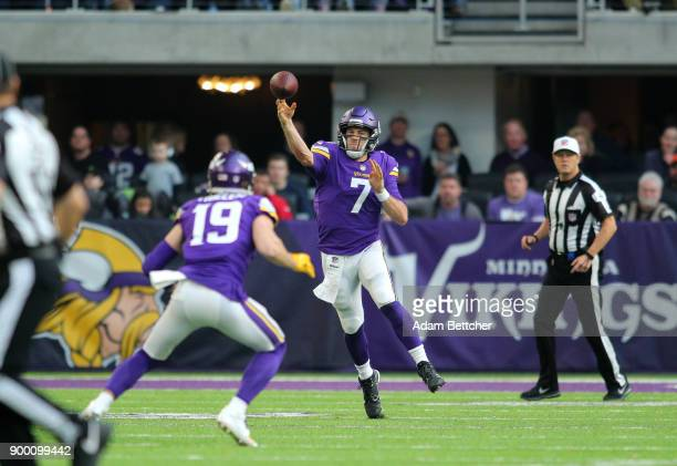 Case Keenum passes the ball to Adam Thielen of the Minnesota Vikings in the second quarter of the game against the Chicago Bears on December 31 2017...