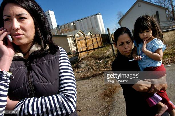 Case manager Andrea Garcia arrives at the home of Cristina Reyes and her 5month old baby Alexis Garcia talks with Cristina's mother Moncerrat Reyes...