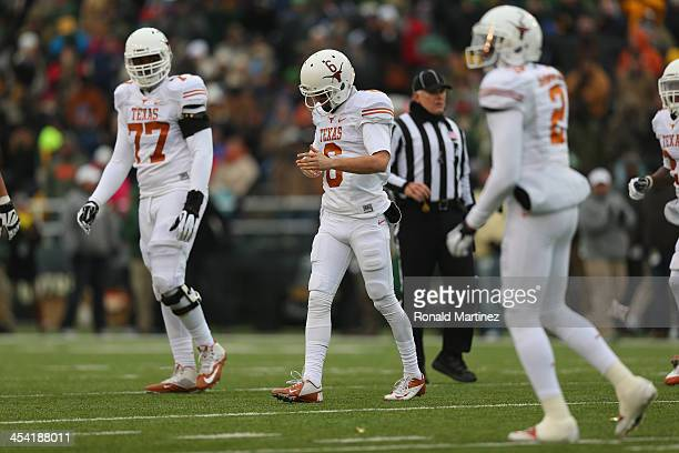 Case McCoy of the Texas Longhorns walks off the field after an incomple pass on third down against the Baylor Bears at Floyd Casey Stadium on...