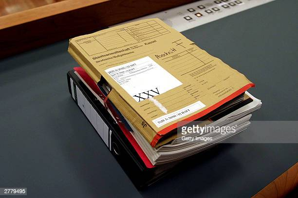Case Notes are seen on a table at the trial of Computer technician Armin Meiwes aged 42 at the prelude to Germany's first cannabalism trial held...