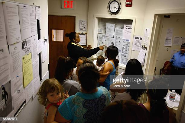 Case worker Anastasia Nixon gives a tour to a new group of homeless women and children at the Family Gateway homeless shelter on June 18, 2009 in...