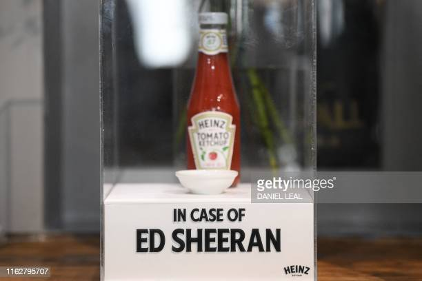 A cased bottle of Heinz tomato ketchup is pictured on display at inside the reopened Swan pub in Ipswich east England on August 19 where British...