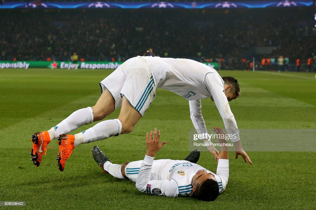 Casemiro and Cristiano Ronaldo of Real Madrid react after his goal during the UEFA Champions League Round of 16 Second Leg match between Paris Saint-Germain and Real Madrid at Parc des Princes on March 6, 2018 in Paris, France.
