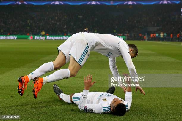 Casemiro and Cristiano Ronaldo of Real Madrid react after his goal during the UEFA Champions League Round of 16 Second Leg match between Paris...