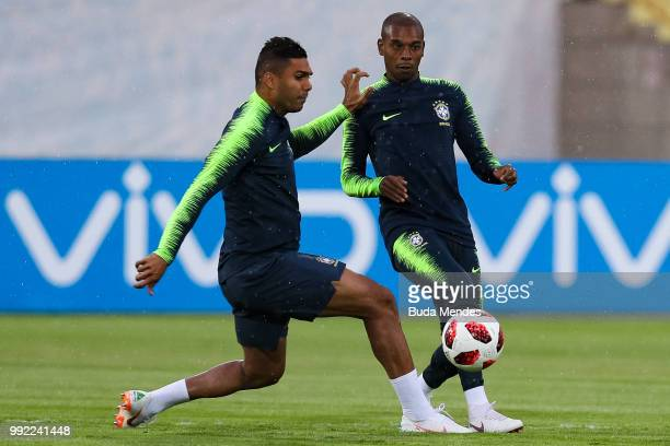 Casemiro and Fernandinho in action during a Brazil training session ahead of the the 2018 FIFA World Cup Russia Quarter Final match between Brazil...