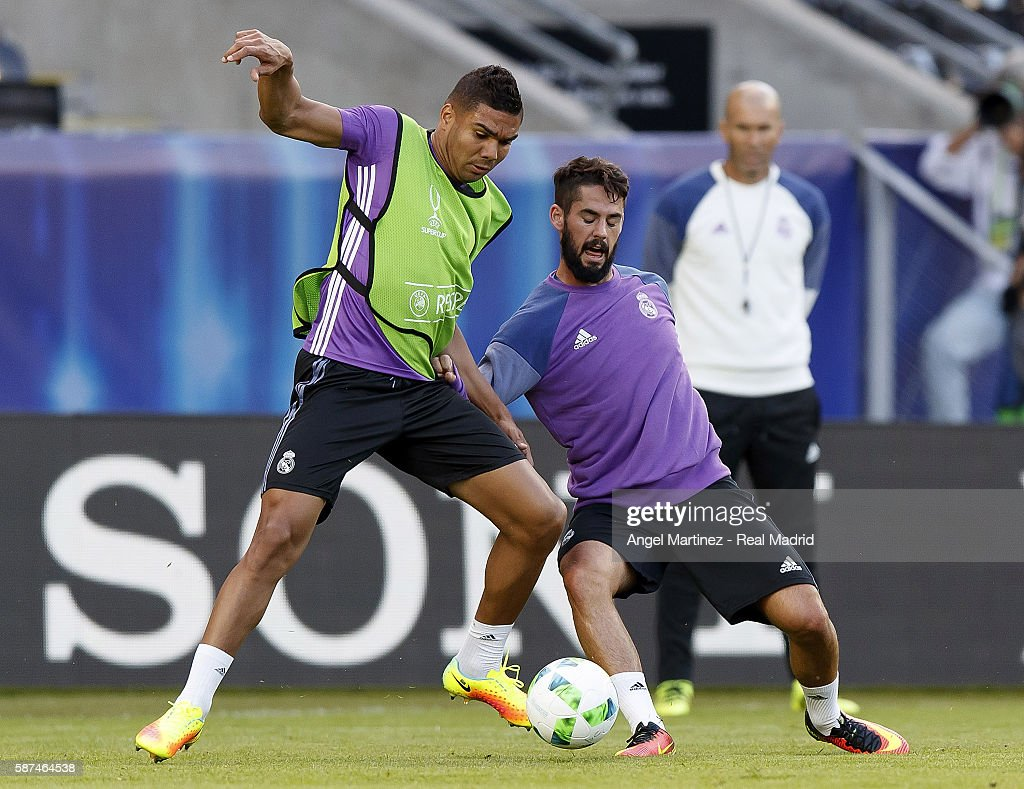 Casemiro (L) and Isco of Real Madrid in action during a training session at Lerkendal Stadion on August 8, 2016 in Trondheim, Norway.