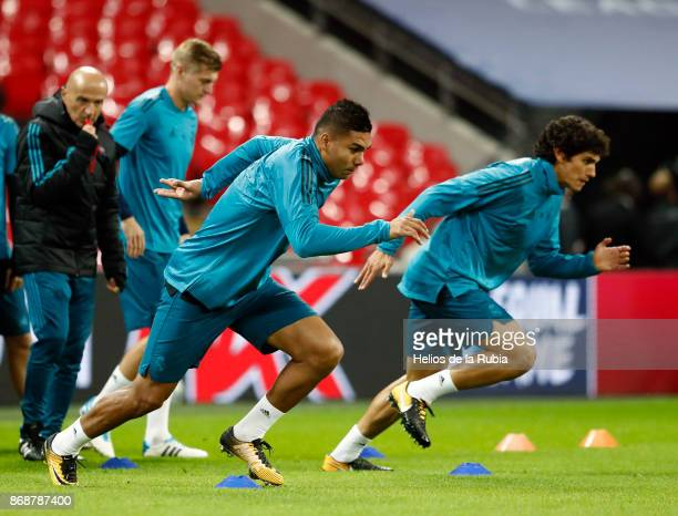Casemiro and Jesus Vallejo of Real Madrid warms up during a training sessions at Wembley Stadium on October 31 2017 in London England