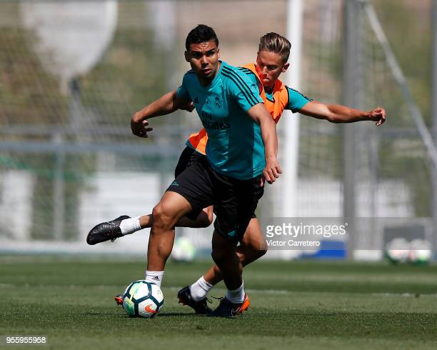 Casemiro and Marcos Llorente of Real Madrid in action during a training session at Valdebebas training ground on May 8 2018 in Madrid Spain