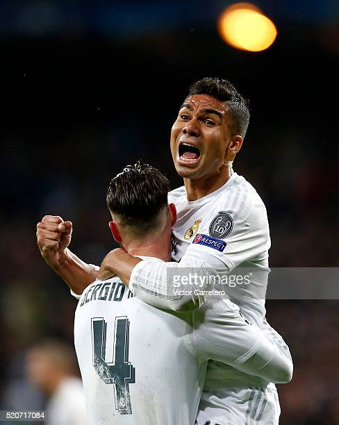 Casemiro and Sergio Ramos of Real Madrid celebrate victory after the UEFA Champions League quarter final second leg match between Real Madrid and VfL...