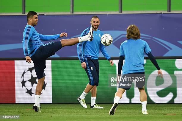 Casemiro, Karim Benzema and Luka Modric in action during a Real Madrid training session ahead of their UEFA Champions League quarter final first leg...