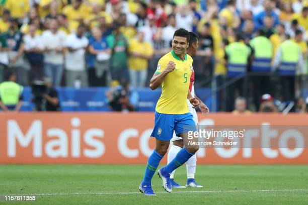 Casemiro of Brazil celebrates after scoring the opening goal during the Copa America Brazil 2019 group A match between Peru and Brazil at Arena...