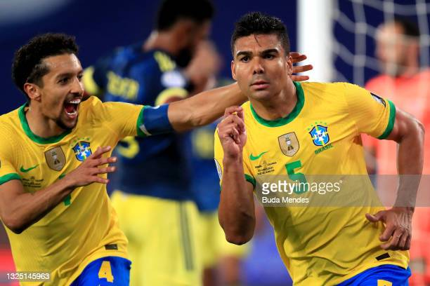 Casemiro of Brazil celebrates with teammate Marquinhos after scoring the second goal of his team during a Group B match between Brazil and Colombia...
