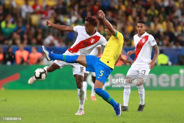 Casemiro of Brazil fights for the ball with Andre Carrillo of Peru during the Copa America Brazil 2019 Final match between Brazil and Peru at...