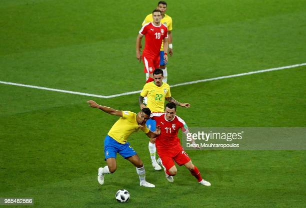 Casemiro of Brazil is challenged by Filip Kostic of Serbia during the 2018 FIFA World Cup Russia group E match between Serbia and Brazil at Spartak...