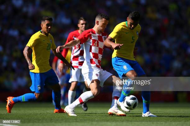 Casemiro of Brazil is challenged by Ivan Perisic of Croatia during the International Friendly match between Croatia and Brazil at Anfield on June 3...