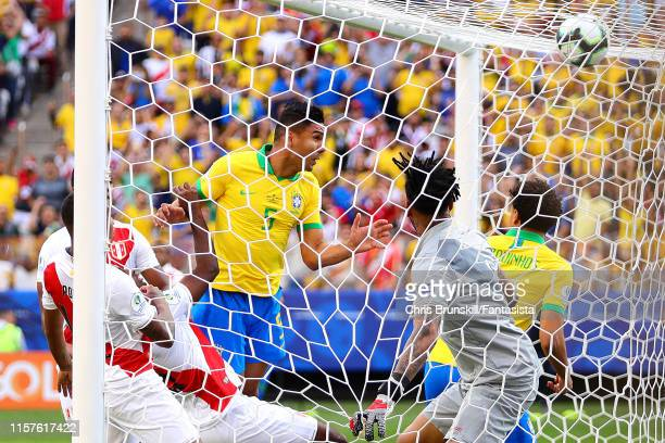 Casemiro of Brazil scores his side's first goal during the Copa America Brazil 2019 group A match between Peru and Brazil at Arena Corinthians on...