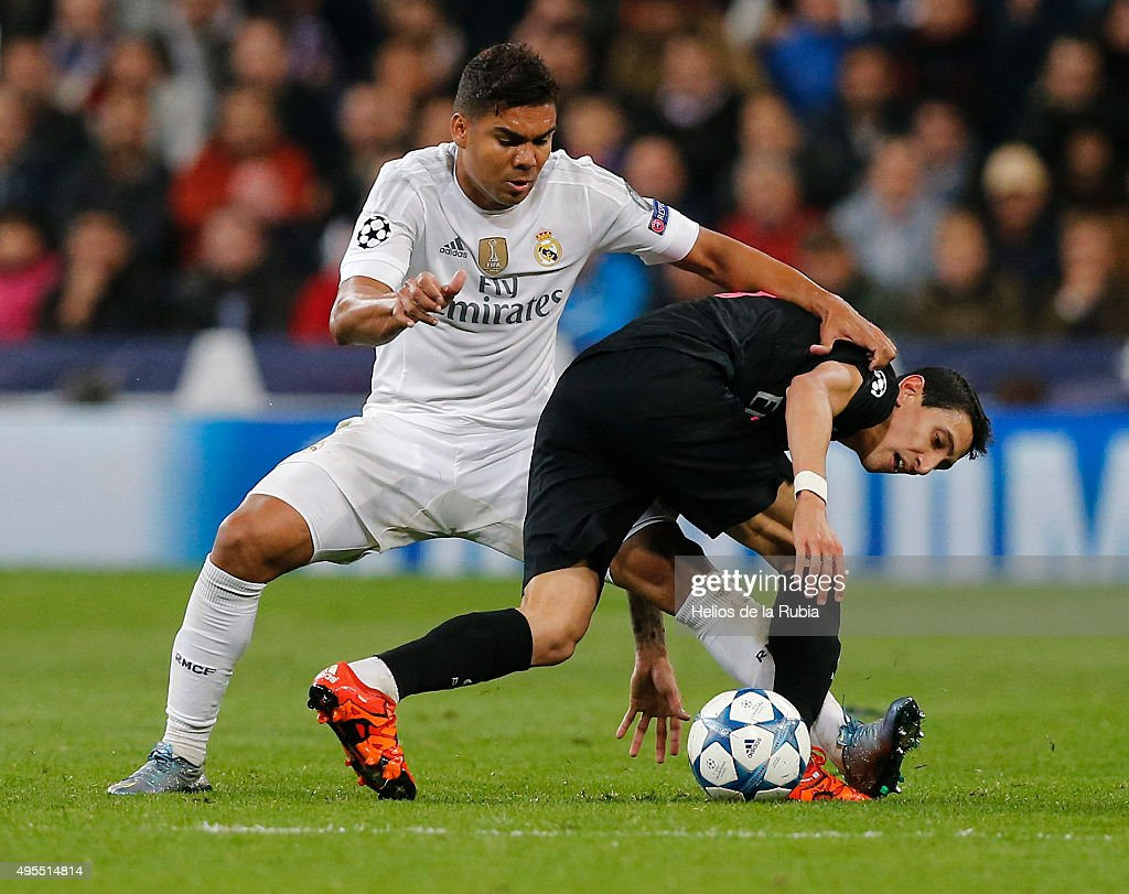 Casemiro (L) of Real Madrid and Angel Di Maria of PSG compete for the ball during the UEFA Champions League Group A match between Real Madrid and Paris Saint-Germain at Estadio Santiago Bernabeu on November 3, 2015 in Madrid, Spain.