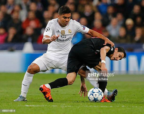 Casemiro of Real Madrid and Angel Di Maria of PSG compete for the ball during the UEFA Champions League Group A match between Real Madrid and Paris...