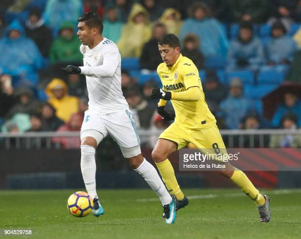 Casemiro of Real Madrid and Pablo Fornals of Villarreal compete for the ball during the La Liga match between Real Madrid and Villarreal at Estadio...