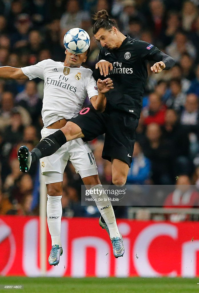 Casemiro (L) of Real Madrid and Zlatan Ibrahimovic of PSG compete for the ball during the UEFA Champions League Group A match between Real Madrid and Paris Saint-Germain at Estadio Santiago Bernabeu on November 3, 2015 in Madrid, Spain.