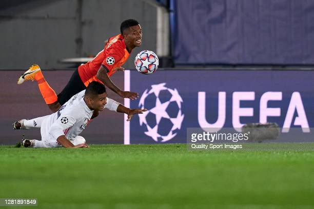 Casemiro of Real Madrid battle for the ball with Marcos Antonio of Shakhtar Donetsk during the UEFA Champions League Group B stage match between Real...