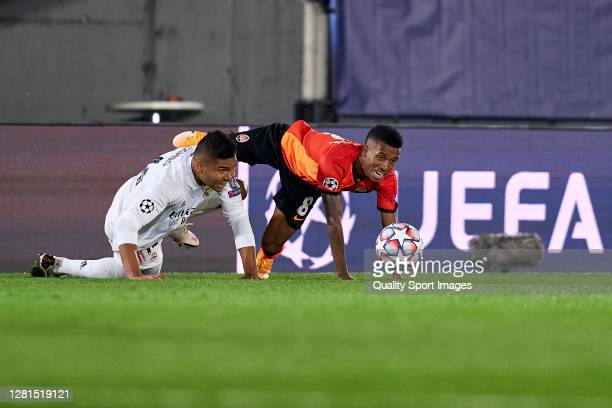 Casemiro of Real Madrid battles for the ball with Marcos Antonio of Shakhtar Donetsk during the UEFA Champions League Group B stage match between...
