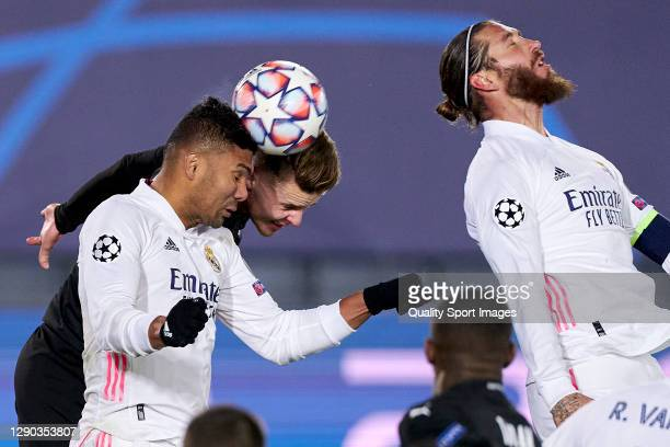 Casemiro of Real Madrid battles for the ball with Oscar Wendt of Borussia Moenchengladbach during the UEFA Champions League Group B stage match...