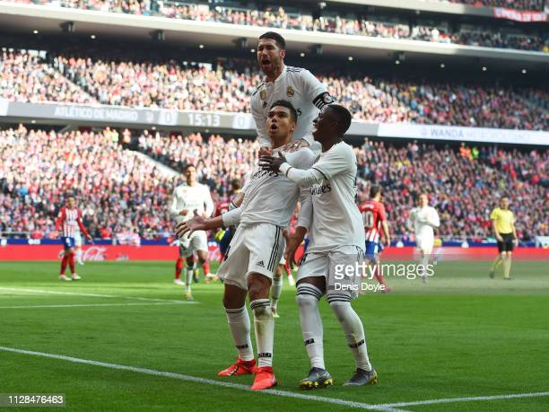 Casemiro of Real Madrid celebrates after scoring his team's first goal with Sergio Ramos and Vinicius Junior during the La Liga match between Club...